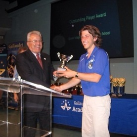 Gianni Maganelli receiving his Academic Bowl Hall of Fame award from President Davilla in 2014